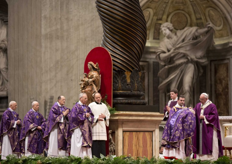 Pope Francis, right, places ashes on the head of a cardinal as he leads the Ash Wednesday mass, in St. Peter's Basilica at the Vatican, Wednesday, Feb. 10, 2016. Pope Francis has smudged ashes on the bowed heads of prelates, nuns and ordinary Catholics during Ash Wednesday Mass in St. Peterís Basilica. The ritual marks the start of Lent, a period of penitence, prayer and self-sacrifice as faithful prepare for Easter. (AP Photo/Alessandra Tarantino)
