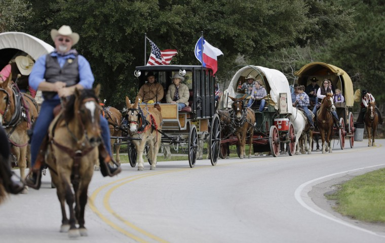 Sam Houston Trail Riders ride toward Spring Creek Park in Tomball, Texas, Tuesday, Feb. 23, 2016. More than 3,000 riders from 13 trail rides will converge in Houston on Friday as part of the Houston Livestock Show and Rodeo. The riders will take part in the downtown rodeo parade on Saturday. (AP Photo/David J. Phillip)