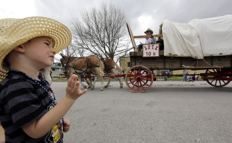 Jayse Baker, 3, waves as the Sam Houston Trail Riders arrive in Tomball, Texas, Tuesday, Feb. 23, 2016. The trail riders are making their way toward Houston for the Houston Livestock Show and Rodeo Downtown Rodeo Parade on Saturday. (AP Photo/David J. Phillip)