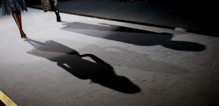 Models cast their shadows on the catwalk during the Ermanno Scervino women's Fall-Winter 2016-2017 fashion show, part of the Milan Fashion Week, unveiled in Milan, Italy, Saturday, Feb. 27, 2016. (AP Photo/Luca Bruno)