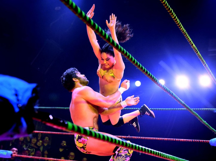 "Wrestlers Joey Ryan and a female opponent fight during the Lucha Va Voom's ""Crazy in Love"" show at the Mayan Theatre in downtown Los Angeles, California on February 10, 2016. (MARK RALSTON/AFP/Getty Images)"