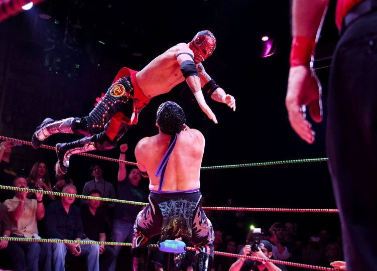 "Wrestler Rey Escorpian is hit by opponent Rey Horus (top) during the Lucha Va Voom's ""Crazy in Love"" show at the Mayan Theatre in downtown Los Angeles, California on February 10, 2016. (MARK RALSTON/AFP/Getty Images)"