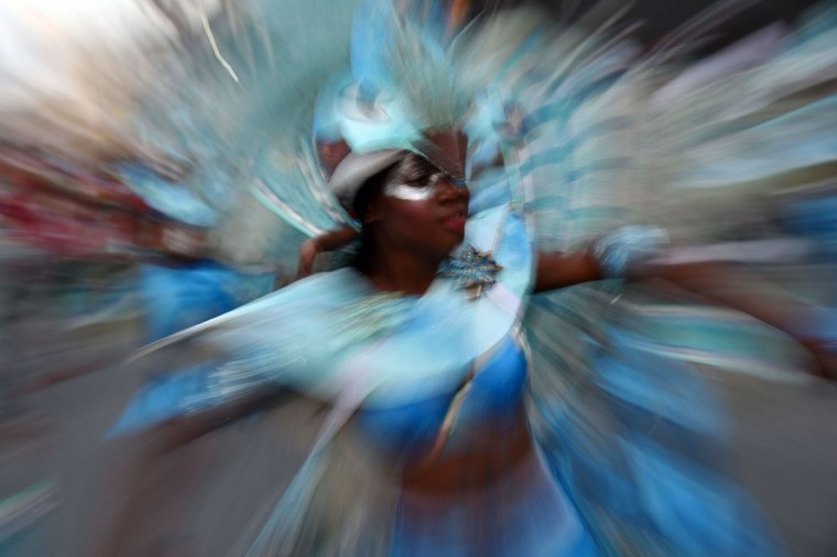 A reveler performs during of 2016 National Carnival Parade on February 9, 2016 in Port-au-Prince, Haiti. (HECTOR RETAMAL/AFP/Getty Images)