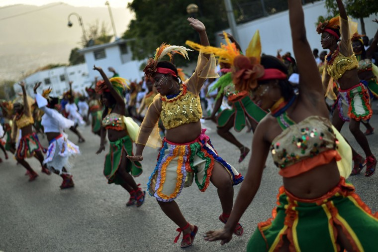 Revelers perform during of 2016 National Carnival Parade on February 9, 2016, in Port-au-Prince, Haiti. (HECTOR RETAMAL/AFP/Getty Images)