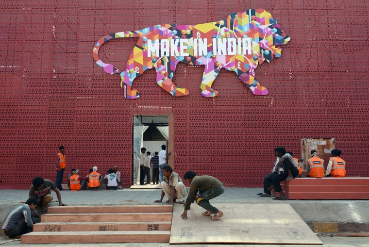 Indian workers set up the venue for the 'Make in India' showcase week in Mumbai on February 11, 2016. (INDRANIL MUKHERJEE/AFP/Getty Images)