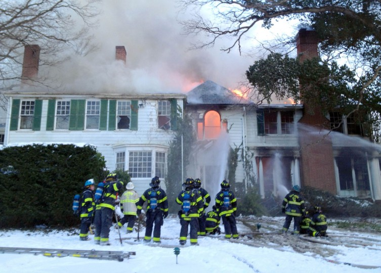 Firefighters work a two-alarm fire on a home in Roland Park on Jan. 23, 2014. (Baltimore Sun photo by Karl Merton)