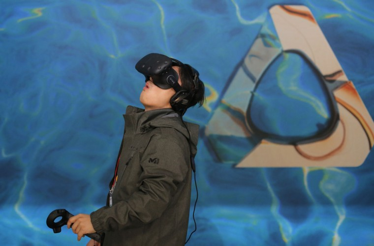 A man uses virtual reality gadgets to play a game during the Mobile World Congress wireless show in Barcelona, Spain, Wednesday, Feb. 24, 2016. (AP Photo/Manu Fernandez)