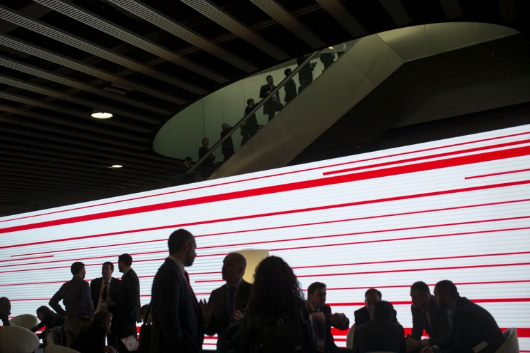 People gather in a meeting point during the Mobile World Congress Wireless show in Barcelona, Spain, Wednesday, Feb. 24, 2016. (AP Photo/Francisco Seco)
