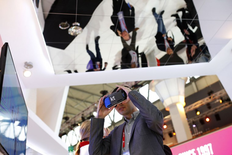 A man uses a virtual reality device during the Mobile World Congress Wireless show in Barcelona, Spain, Tuesday, Feb. 23, 2016. (AP Photo/Francisco Seco)