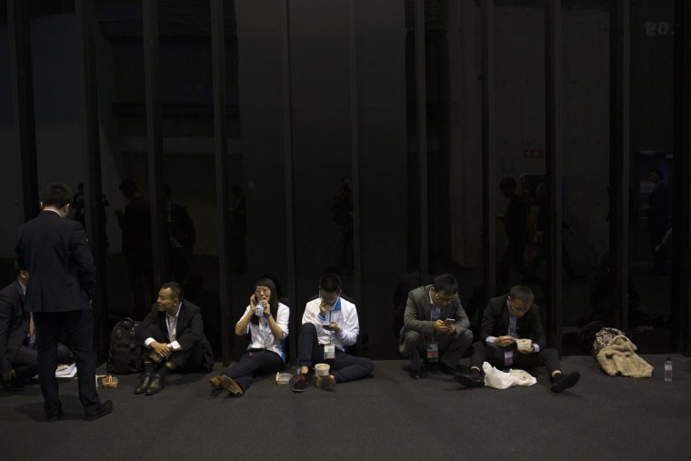 People have a break during the Mobile World Congress Wireless show in Barcelona, Spain, Tuesday, Feb. 23, 2016. (AP Photo/Francisco Seco)