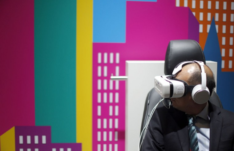 A visitor uses a Samsung Gear VR headset during the during the Mobile World Congress wireless show in Barcelona, Spain, Tuesday, Feb. 23, 2016. (AP Photo/Manu Fernandez)