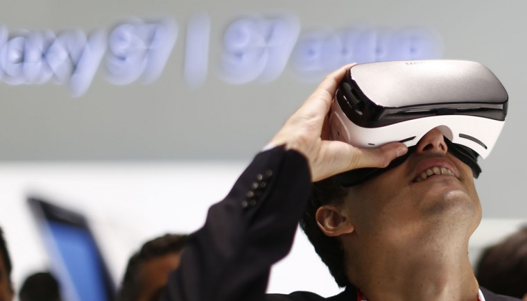 A visitor uses the new Samsung Gear 360, a 360-degree camera during the Mobile World Congress wireless show in Barcelona, Spain, Tuesday, Feb. 23, 2016. (AP Photo/Manu Fernandez)
