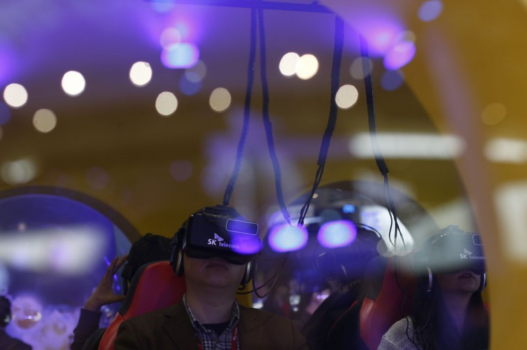 A man uses virtual reality glasses during the Mobile World Congress wireless show in Barcelona, Spain, Tuesday, Feb. 23, 2016. (AP Photo/Manu Fernandez)