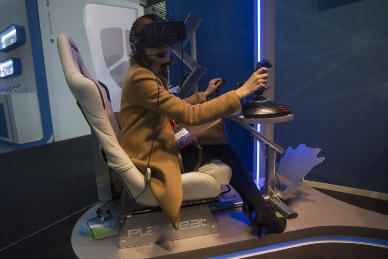 A woman uses virtual reality gadgets to play a game during the Mobile World Congress Wireless show in Barcelona, Spain, Wednesday, Feb. 24, 2016. Companies like Samsung, LG and HTC are showing off their latest virtual reality headsets as others are showing new content or new applications for a virtual reality world which is one of the big trends at the Mobile World Congress show in Barcelona. (AP Photo/Francisco Seco)