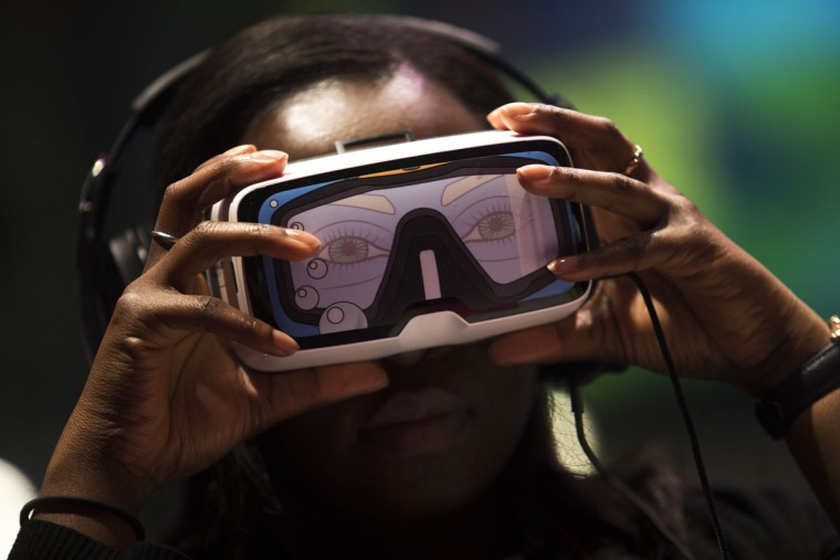 A woman uses a virtual reality device during the Mobile World Congress Wireless show in Barcelona, Spain, Wednesday, Feb. 24, 2016. Companies like Samsung, LG and HTC are showing off their latest virtual reality headsets as others are showing new content or new applications for a virtual reality world which is one of the big trends at the Mobile World Congress show in Barcelona. (AP Photo/Francisco Seco)