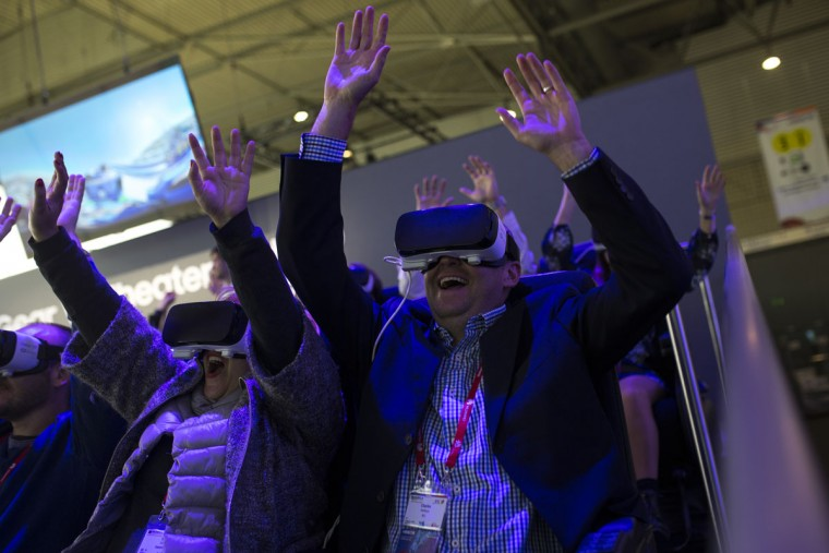 People react as they use the new Samsung Gear 360, a 360-degree camera, during the Mobile World Congress Wireless show in Barcelona, Spain, Wednesday, Feb. 24, 2016. Companies like Samsung, LG and HTC are showing off their latest virtual reality headsets as others are showing new content or new applications for a virtual reality world which is one of the big trends at the Mobile World Congress show in Barcelona. (AP Photo/Francisco Seco)
