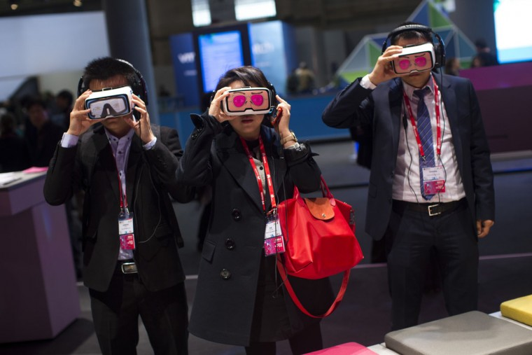 Visitors use virtual reality devices during the Mobile World Congress Wireless show in Barcelona, Spain, Wednesday, Feb. 24, 2016. (AP Photo/Francisco Seco)