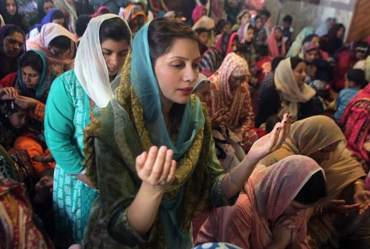 Christian women pray during an Easter service at St Anthony's Church in Lahore, Pakistan, Sunday, March 27, 2016. Christians across the world are celebrating Easter, commemorating the day followers believe Jesus was resurrected in Jerusalem over 2,000 years ago. (AP Photo/K.M. Chaudary)
