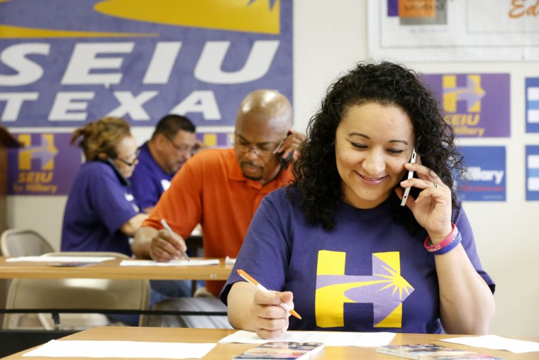 Volunteers Maria Nuno-Estrada (R) and Rudy Anderson speak with a voter on Super Tuesday at Democratic presidential candidate Hillary Clinton's Dallas headquarters March 1, 2016 in Dallas, Texas. 13 states and American Samoa are holding presidential primary elections, with over 1400 delegates at stake. (Photo by Ron Jenkins/Getty Images)