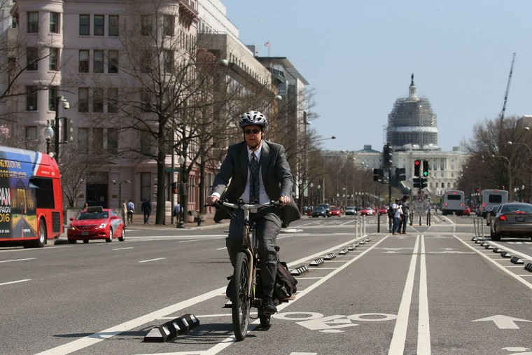A man rides a bicycle on Pennsylvania Ave., March 16, 2016 in Washington, DC. Metrorail has shut down service entirely today for emergency inspections of the system's third-rail power cables after a tunnel fire earlier in the week. (Photo by Mark Wilson/Getty Images)
