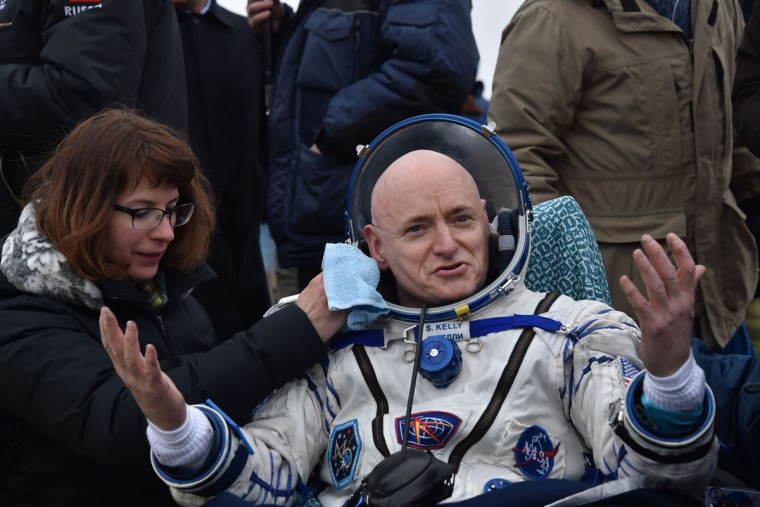 International Space Station (ISS) crew member Scott Kelly of the U.S. reacts after landing near the town of Dzhezkazgan, Kazakhstan, on March 2, 2016. (KIRILL KUDRYAVTSEV/AFP/Getty Images)