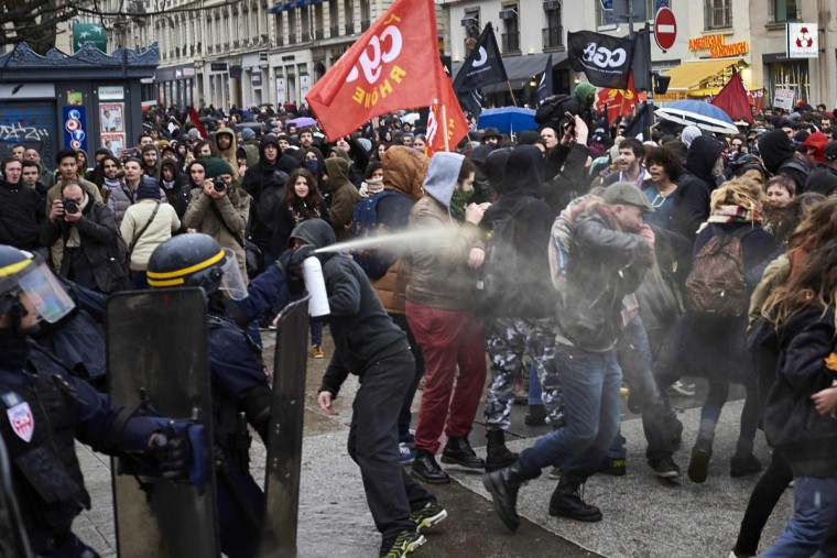 Police fire tear gas at protesters during a demonstration on March 9, 2016, in Lyon, central-eastern France, as part of a nationwide day of protest against proposed labour reforms. France faced a wave of protests on March 9 against deeply unpopular labour reforms that have divided an already-fractured Socialist government and raised hackles in a country accustomed to iron-clad job security. A protester clashes with police during a demonstration on March 9, 2016, in Lyon, central-eastern France, as part of a nationwide day of protest against proposed labour reforms. France faced a wave of protests on March 9 against deeply unpopular labour reforms that have divided an already-fractured Socialist government and raised hackles in a country accustomed to iron-clad job security. (AFP / Jean-Philippe Ksiazek)