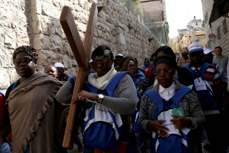 Catholic pilgrims from Ivory Cost carry a wooden cross along the Via Dolorosa (Way of Suffering) in Jerusalems Old City during the Good Friday procession on March 25, 2016. Many Christian pilgrims took part in processions along the route where according to tradition Jesus Christ carried the cross during his last days. (Gali Tibbon/AFP/Getty Images)