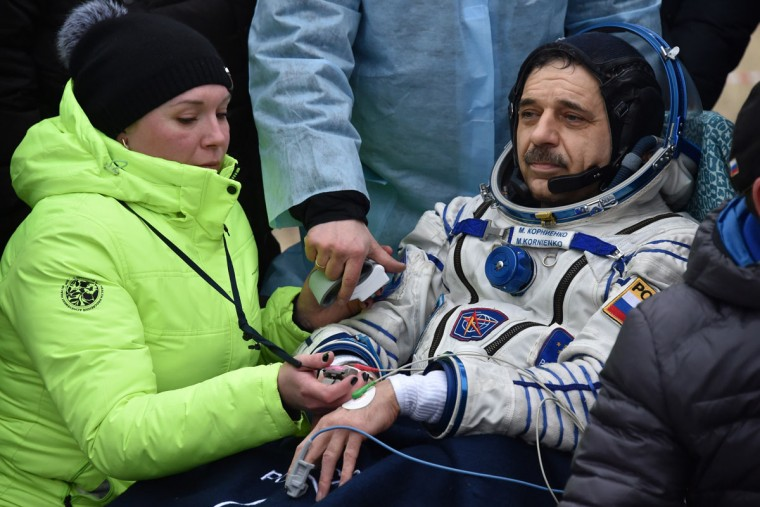 Medics check International Space Station (ISS) crew member Mikhail Kornienko of Russia after landing near the town of Dzhezkazgan, Kazakhstan, on March 2, 2016. (KIRILL KUDRYAVTSEV/AFP/Getty Images)
