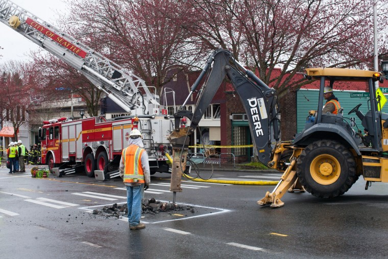 Seattle Public Utilities employees work to repair a gas line after an explosion destroyed businesses on Greenwood Avenue on March 9, 2015 in Seattle, Washington. Nine firefighters who were battling the blaze were injured, but have since been released from Harborview Medical Center according to Seattle Fire Department. (Matt Mills McKnight/Getty Images)