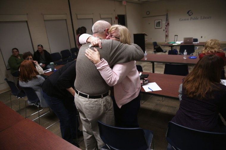 GROTON, CT - MARCH 23: Parents of heroin and opioid addicts embrace during a family addiction support group on March 23, 2016 in Groton, CT. The group Communities Speak Out organizes monthly meetings at a public library for family members to talk about how their loved ones' addiction affects them and to give each other emotional support. Communities nationwide are struggling with the unprecidented heroin and opioid pain pill epidemic. On March 15, the U.S. Centers for Disease Control (CDC), announced guidelines for doctors to reduce the amount of opioid painkillers prescribed nationwide, in an effort to curb the epidemic. The CDC estimates that most new heroin addicts first became hooked on prescription pain medication before graduating to heroin, which is stronger and cheaper. (John Moore/Getty Images)