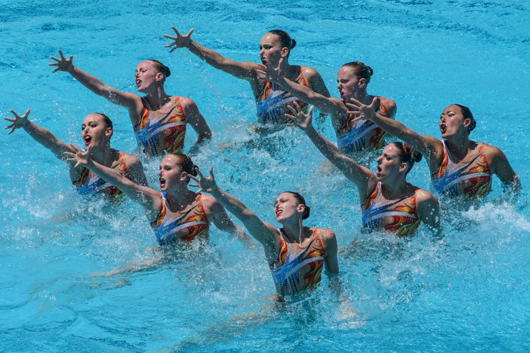 The synchronized swimming team of Canada performs during the teams' free routine final of the FINA Synchronized Swimming Olympic Games Qualification Tournament at the Maria Lenk Aquatic Centre in Rio de Janeiro, Brazil, on March 6, 2016. (Yasuyoshi Chiba/AFP/Getty Images)