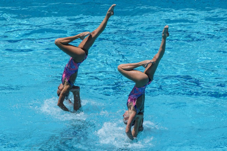 The synchronized swimming team of Ukraine performs during the teams' free routine final of the FINA Synchronized Swimming Olympic Games Qualification Tournament at the Maria Lenk Aquatic Centre in Rio de Janeiro, Brazil, on March 6, 2016. (Yasuyoshi Chiba/AFP/Getty Images)