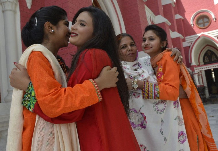 "Pakistani Christians embrace after attending an Easter service at a church in Lahore on March 27, 2016. Pope Francis spoke out against the ""rejection"" of refugees as the European migrant crisis saw its latest desperate scenes on the Greek border with Macedonia. The pontiff used his Easter address to urge people to offer ""welcome and assistance"" to those fleeing war and poverty, as Europe struggles with its worst migration crisis since World War II. (AFP PHOTO / ARIF ALI)"