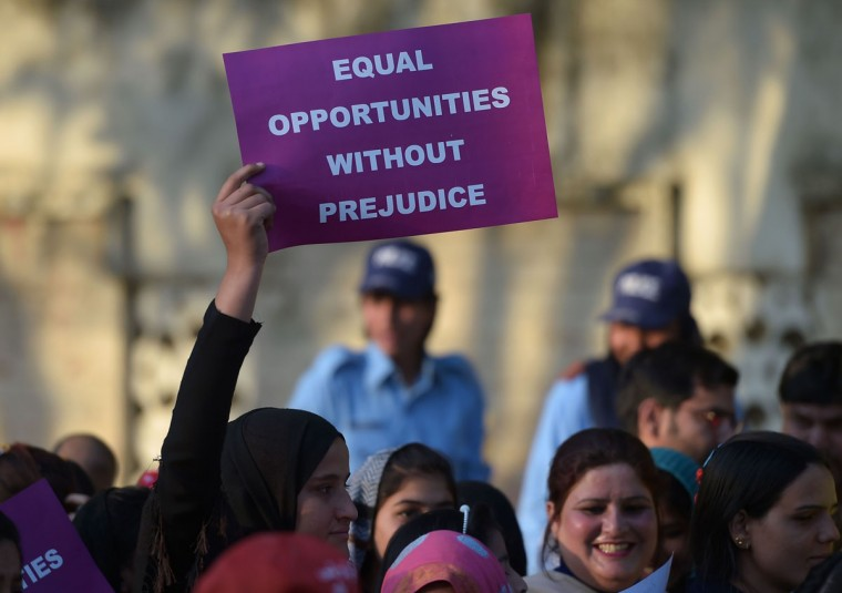 Pakistani civil society activists march during a rally to mark International Women's Day in Islamabad on March 8, 2016. Women in conservative Pakistan have fought for their rights for decades, in a country where so-called honor killings and acid attacks remain commonplace. (Aamir Qureshi/AFP/Getty Images)