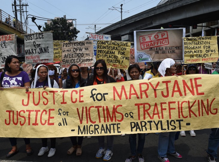Members of Gabriela women's group along with Migrant workers' union hold placards during a rally to celebrate International Women's Day near Malacanang Palace in Manila on March 8, 2016. Dozens of women joined the rally and assailed the government of its export labour policy citing the case of Filipina worker Mary Jane Veloso, a convicted drug mule but given reprieved by the Indonesian government last April 29, 2015. (Ted Aljibe/AFP/Getty Images)