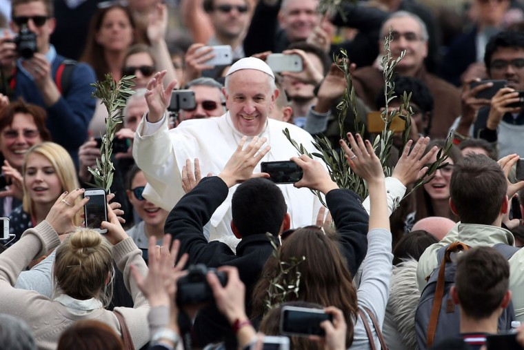 VATICAN CITY, VATICAN - MARCH 20: Pope Francis waves to the faithful as he leaves St. Peter's Square at the end of the Palm Sunday Mass on March 20, 2016 in Vatican City, Vatican. Pope Francis on Sunday presided at the Procession and Mass for Palm Sunday, as the Church enters into the celebration of Holy Week. Palm Sunday commemorates the triumphal entry of Jesus into Jerusalem one week before His Passion, Death, and Resurrection. (Franco Origlia/Getty Images)