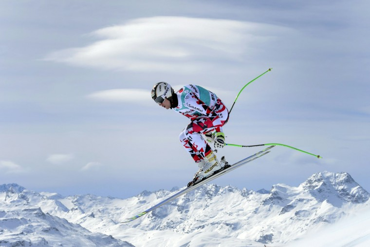 Austria's Hannes Reichelt jumps during the men's downhill practice at the FIS Alpine Ski World Cup Finals, in St. Moritz on March 15, 2016. (Fabrice Coffrini/AFP/Getty Images)