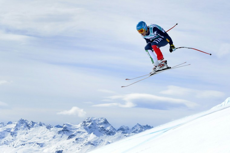 Italy's Christof Innerhofer jumps during the men's downhill practice at the FIS Alpine Skiing World Cup finals on March 15, 2016 in St. Moritz. (Fabrice Coffrini/AFP/Getty Images)