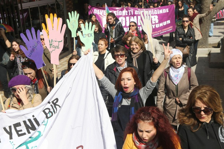 Turkish women shout slogans as they carry different types of banners during a demonstration marking International Women's Day in Ankara on March 6, 2016. (Adem Altan/AFP/Getty Images)