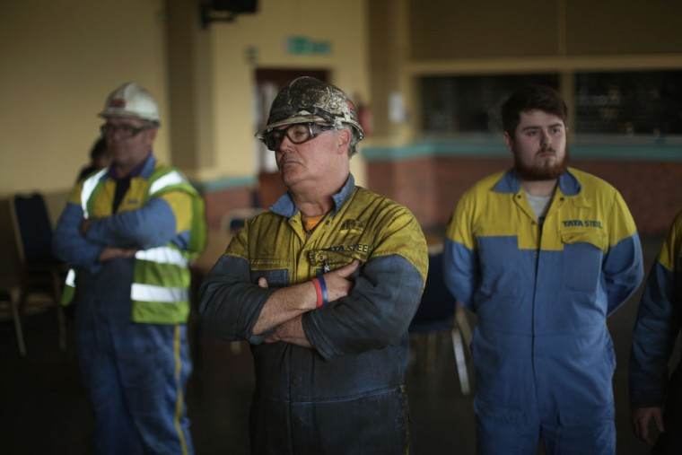 Workers from the Tata Steel plant listen to labour leader Jereym Corbyn speak to workers and union members at the Tata Sports Club on March 30, 2016 in Port Talbot, Wales. Indian owners Tata Steel put its British business up for sale yesterday, placing thousands of jobs at risk and hitting the already floundering UK steel industry. (Photo by Christopher Furlong/Getty Images)