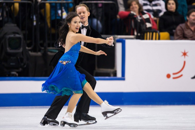 Madison Chock and Evan Bates of the United States skate during the Ice Dance short dance at the ISU World Figure Skating Championships at TD Garden in Boston, Massachusetts, March 30, 2016. /(Geoff Robins/AFP/Getty Images)