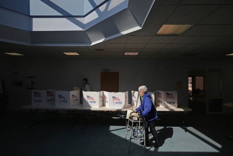 Voters cast their ballots at the polling place at Fairfax Circle Baptist Church during Super Tuesday voting March 1, 2016 in Fairfax, United States. Officials are expecting a record turn out of voters in Virginia, one of a dozen states holding presidential primaries or caucuses. (Photo by Chip Somodevilla/Getty Images)