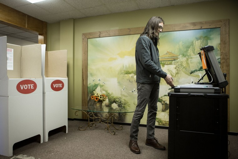 Scott Stuckey of Oklahoma City feeds a ballot into an optical scanner at Trinity Baptist Church on Super Tuesday March 1, 2016 in Oklahoma City. Oklahoma voters head to the polls for the 2016 Presidential Primary. (Photo by Brett Deering/Getty Images)