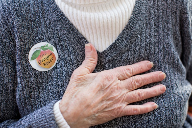 "Edna Martinez wears a ""I'm a Georgia Voter"" sticker after casting her ballot at Taylorsville Town Hall on Super Tuesday March 1, 2016, in Taylorsville, Georgia. Voters head to the polls to cast their votes on Georgia's presidential primary. (Photo by Branden Camp/Getty Images)"