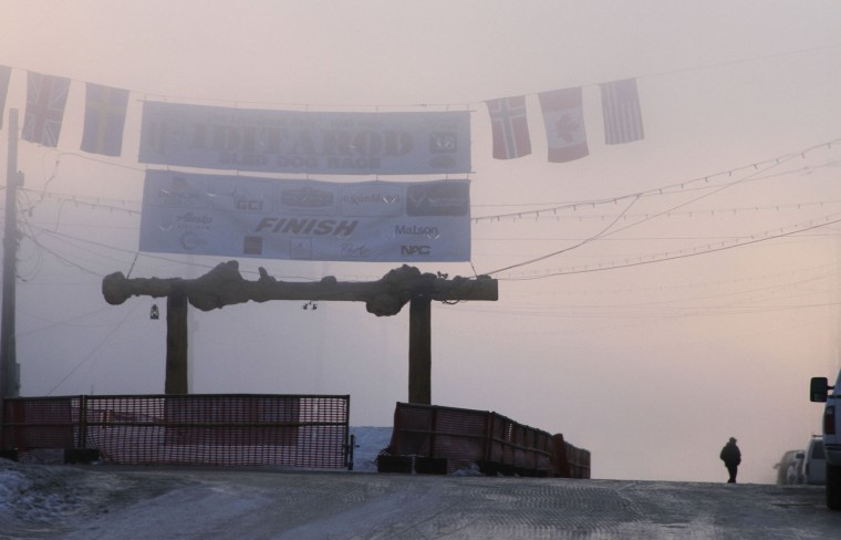 Fog obscures the burled arch over the finish line of the Iditarod Trail Sled Dog Race in Nome, Alaska, on Thursday, March 17, 2016. Eighty-five mushers began the nearly 1,000-mile race to Nome from Anchorage on March 6. As of Thursday morning, 43 mushers had reached Nome, 13 have scratched and 29 remain on the trail. (AP Photo/Mark Thiessen)