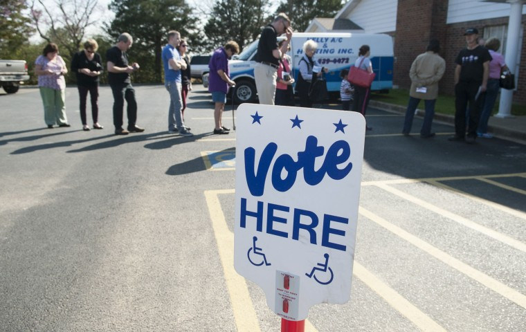 Voters are lined up into parking lot at Flint Baptist Church waiting to vote in the primary election in Flint, Texas Tuesday afternoon March 1, 2016. (Sarah A. Miller/Tyler Morning Telegraph via AP)