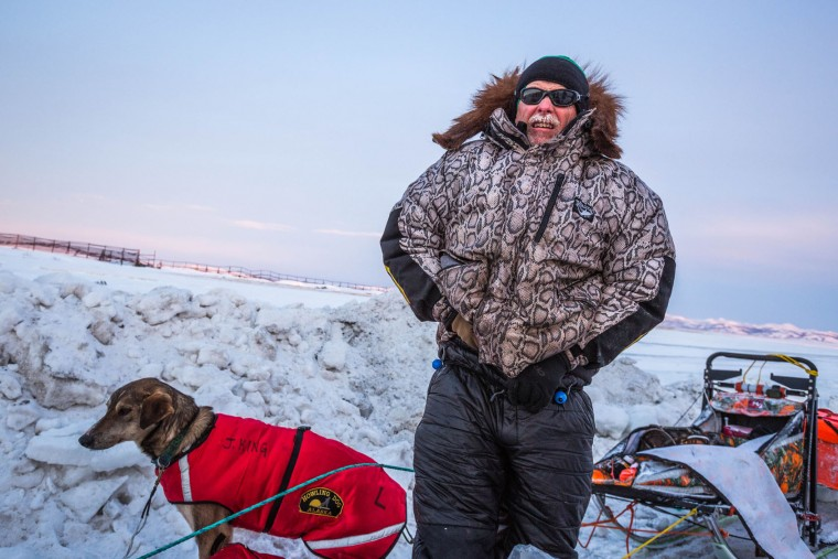 In this March 15, 2015 file photo, Jeff King is photographed after arriving at the Unalakleet, Alaska. checkpoint in the Iditarod. A person on a snowmobile drove into two dog teams competing in the Iditarod Trail Sled Dog Race early Saturday March 12, 2016, killing one dog and injuring at least three others. Mushers Aliy Zirkle and Jeff King were attacked outside the village of, a community of 236 on the Yukon River a little more than halfway into the 1,000-mile (1,600-kilometer) race to Nome. (Loren Holmes/Alaska Dispatch News via AP)