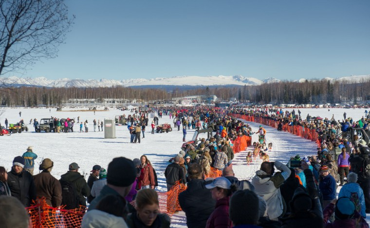 Iditarod Trail Sled Dog Race musher Kelly Maixner begins his race to Nome amongst a crowd of spectators Sunday, March 6, 2016 in Willow, Alaska. (AP Photo/Michael Dinneen)