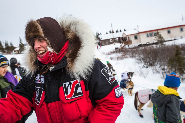 In this March 16, 2015 file photo, Aliy Zirkle arrives at the Koyuk, Alaska, checkpoint during the Iditarod Trail Sled Dog Race. A person on a snowmobile drove into two dog teams competing in the Iditarod Trail Sled Dog Race early Saturday March 12, 2016, killing one dog and injuring at least three others. Mushers Aliy Zirkle and Jeff King were attacked outside the village of, a community of 236 on the Yukon River a little more than halfway into the 1,000-mile (1,600-kilometer) race to Nome. (Loren Holmes/Alaska Dispatch News via AP)