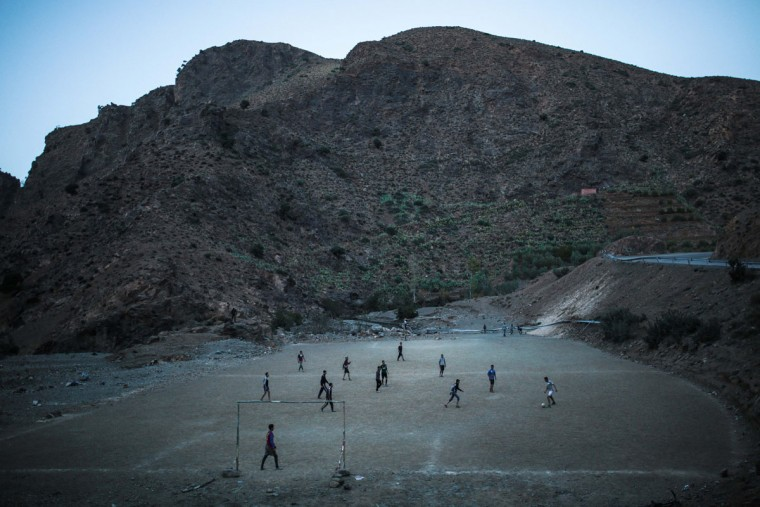 Amazigh boys play football underneath the High Atlas mountains, near Ouarzazate, central Morocco. Across North Africa, the Berbers number about 50 million. At least 15 million Moroccans are Amazigh, divided into different groups according to their dialects. While they speak the native Amazigh language of Tamazight, which has a large number of dialects and recently gained recognition as an official language in Morocco, many have adopted Arabic as part of a long process of Arabization and Islamization. (AP Photo/Mosa'ab Elshamy)